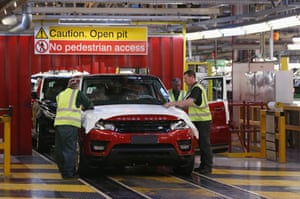 Range Rovers and Land Rovers are built on the production line at the Jaguar Land Rover factory on January 10, 2014 in Solihull, England.