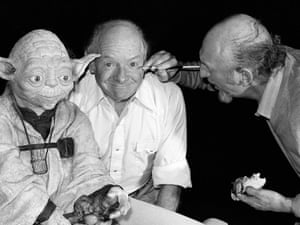 Irvin Kershner, director of the Empire Strikes Back, applies make-up to Stuart Freeborn who created Yoda's look as is known as the grandfather of modern makeup design.