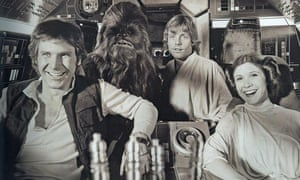 Harrison Ford, Peter Mayhew, as Chewbacca, Mark Hamill and Carrie Fisher share a lighter moment on set.