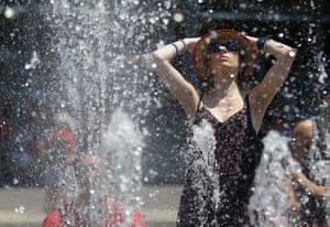 It's really hot in Australia: A tennis fan cools down in the fountain in the scorching heat at the Australian Open tennis championship in Melbourne.