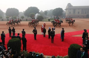 Plenty of red carpet is in evidence as India's President Pranab Mukherjee and Prime Minister Manmohan Singh (wearing the blue turban) wait to receive South Korean President Park Geun-Hye at the forecourt of India's presidential palace in New Delhi.