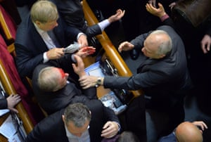 There's been a bit of a fracas in the Ukrainian parliament. A deputy of the pro-Russian majority with blood on his face following an argument with a pro-EU opposition MP during a session to debate the 2014 state budget.