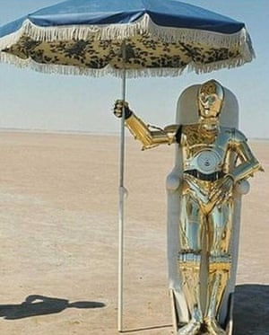 Anthony Daniels, as C-3PO, tries to cool off.