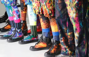 Models present shoes by Japanese designer Yusuke Takahashi for Issey Miyake's men's fall-winter 2014-2015 fashion collection on show in Paris.