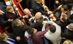 Deputies clash during a debate prior to a vote on the country's budget for 2014