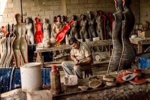 Well endowed mannequins: Workers construct mannequins at Eliezer Alvarez's workshop in Valencia, Ven