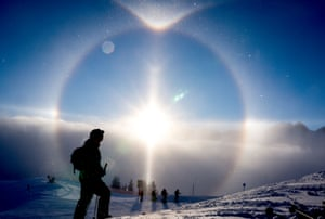 The sun creates a halo over skiers at Fellhorn in Oberstdorf, Germany. Also called a nimbus or icebow, a sun halo is a natural phenomenon created by refractions from ice crystals suspended in the air.