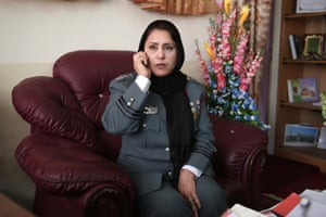 Afghanistan's first-ever female district police chief, Col. Jamila Bayaz, talks on the phone at her office in Kabul, Afghanistan.