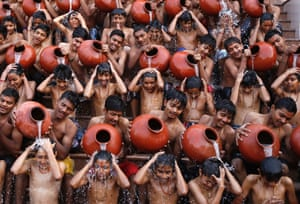 Students pour water on each other as they take a holy bath on the occasion of Magh Purnima in the western Indian city of Ahmedabad.