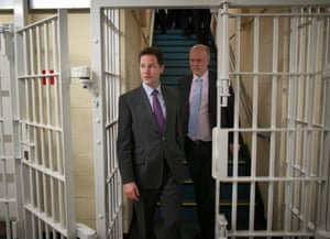 Behind bars: Deputy Prime Minister Nick Clegg and Justice Minister Chris Grayling visit the Cookham Wood Young Offenders Institution in Rochester, Kent.