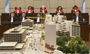 Judges in the Special Tribunal for Lebanon sit behind the scale model