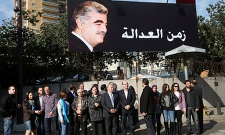 Supporters of Lebanon's Rafik Hariri gather under a billboard with his portrait