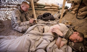 Bowe Bergdahl (sitting) at an observation post near Malakh, Afghanistan, in 2009, when he was part of a team building an base for the Afghan National Army