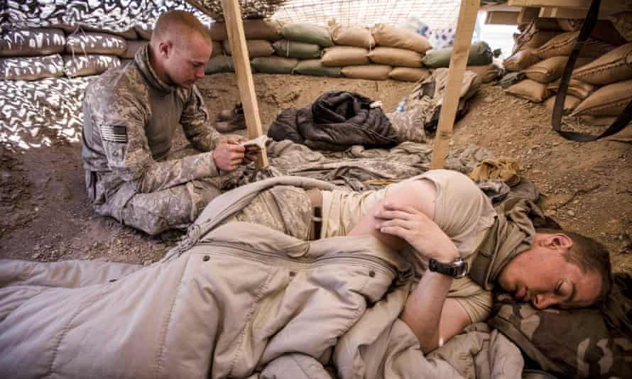 Bowe Bergdahl (sitting) at an observation post near Malakh, Afghanistan, in 2009, when he was part of a team building a base for the Afghan army.