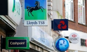 Signs outside branches of some of Britain's big five banks, which control 87% of current accounts