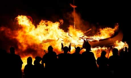 Flames engulf a Viking longboat at the Up Helly Aa festival in Lerwick, Shetland Islands