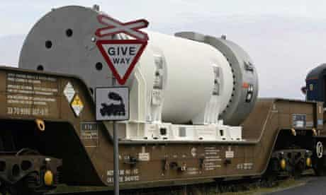 A cylinder containing nuclear waste is transported by rail to Sellafield