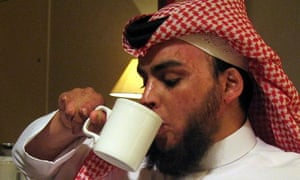 Ahmed al-Shayea drinks from a mug during an interview in 2007
