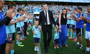 Brett Emerton and his family receive a guard of honour from Sydney players and staff before the 1-0 defeat against Central Coast Mariners.