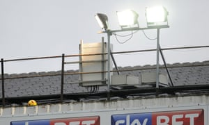 A ball stuck on the roof of a football stand, but where?