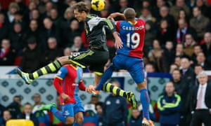 Crystal Palace's Danny Gabbidon leaps to challenge Stoke's Peter Crouch.