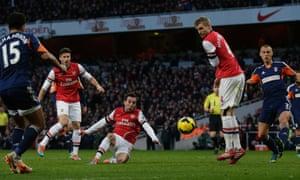 Arsenal's tiny midfielder, Santi Cazorla, scores.
