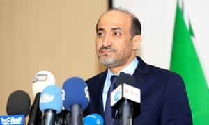 The SNC leader Ahmad al-Jarba addresses a media conference after the vote.