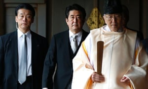 Shinzo Abe visits the Yasukuni shrine. China's ambassador to London has said the gesture risks pushing the region down the road to conflict