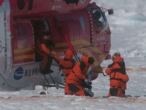 The Chinese helicopter touches down on a landing pad marked out in the ice
