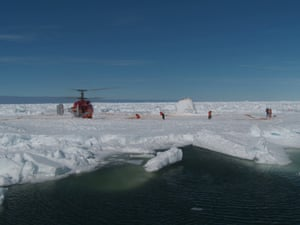 Crew emerge from the Chinese helicopter that has arrived at the trapped Antarctic expedition ship