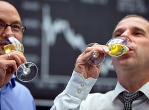 Brokers drink sparkling wine at the German Stock Exchange in Frankfurt Main, Germany, 30 December 2013.