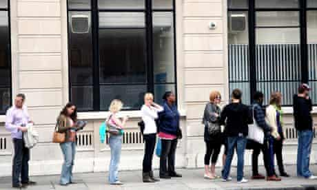 Customers queuing for cash machine