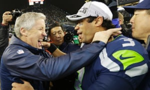 Seattle Seahawks head coach Pete Carroll celebrates with quarterback Russell Wilson after they defeated the San Francisco 49ers 23-17 to advance to Super Bowl XLVIII.