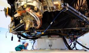 An Esa scientist examining of the Rosetta comet-chasing spacecraft