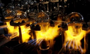 Incandescent bulbs being sealed on a blazing machine