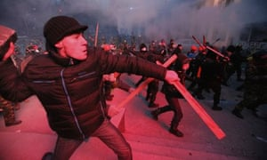 Protesters clash with police in Kiev, Ukraine, on Sunday.