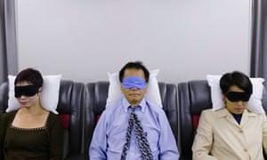 Passengers asleep on a plane
