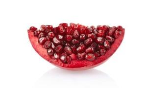 Pomegranate slice on white
