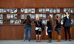 Visitors in front of photos of victims of the Berlin Wall, Berlin Wall Memorial