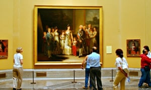 Tourists admire Charles IV and family by Goya at the Madrid Museo del Prado