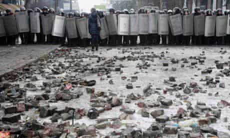 Riot police block a street in Kiev