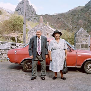 Big Picture - Empire: Elderly couple stand in front of a red car