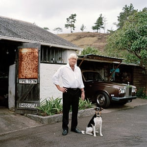 Big Picture - Empire: man with white hair stands next to dog outside house
