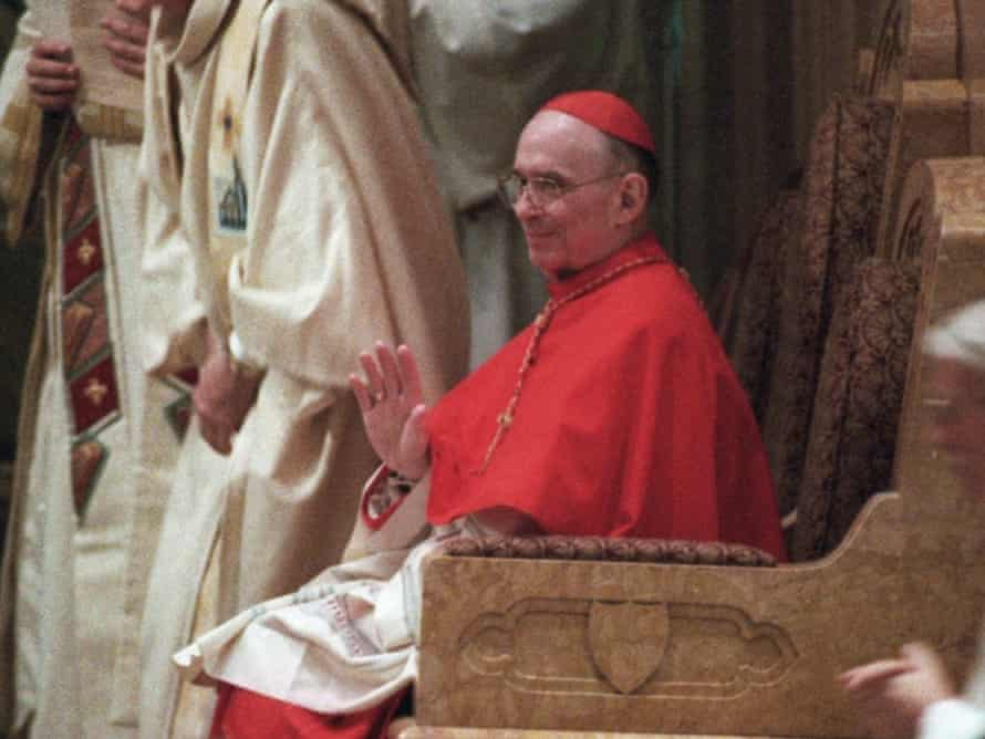 Cardinal Joseph Bernardin sits during a 1996 service in Chicago archdiocese