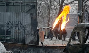 Protesters throw molotov cocktails during clashes.