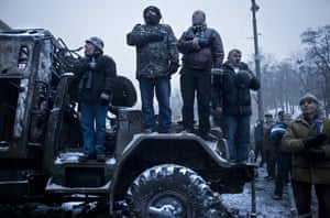 Anti government protesters chant the Ukrainian anthem as they stand on a truck during standoff with riot units on Hrushevskoho street.
