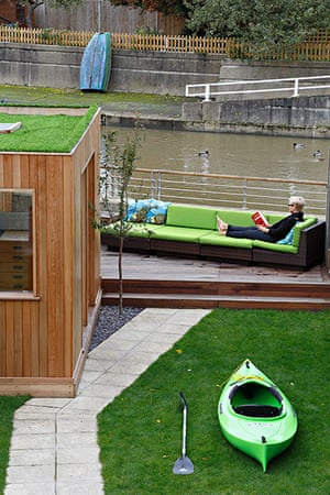 Homes - Petra Tyler: garden with decked area and green sofa