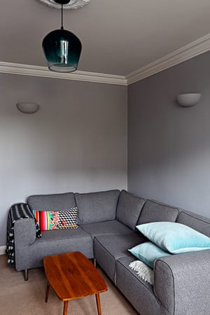 Homes - Petra Tyler: lounge with grey walls and grey sofa