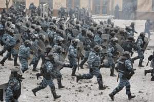 Ukrainian riot police attack protesters.