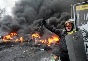 A pro-European protester swings a metal chain during clashes.